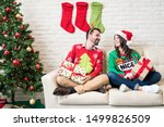 happy couple in ugly sweater... | Shutterstock . vector #1499826509
