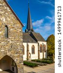 The historical Church of St. Peter and St. Paul in Wiltz, Luxembourg exterior partial view on a sunny autumn day