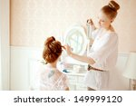 hair stylist makes the bride on ... | Shutterstock . vector #149999120