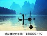 Man Fishing With Cormorants...
