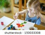 cute little girl is drawing... | Shutterstock . vector #150033308