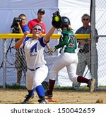Small photo of SHERBROOKE, CANADA - August 7: Alberta's Mackenzie Bender and New Brunswick's Abagail Macgowan compete in women's softball at the Canada Games August 7, 2013 in Sherbrooke, Canada.