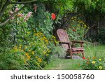 a weathered wood chair sits at...