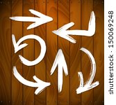 vector arrows on wooden plank... | Shutterstock .eps vector #150069248