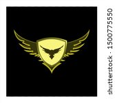 gold badge or emblem with wings ...