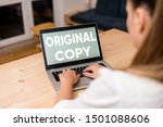 Small photo of Conceptual hand writing showing Original Copy. Business photo text Main Script Unprinted Branded Patented Master List woman with laptop smartphone and office supplies technology.