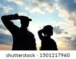 Soldiers In Uniform Saluting...