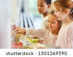 Stock photo children pick up food at the cafeteria buffet in kindergarten or elementary school 1501269590
