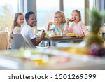 Stock photo group of kids as friends having lunch in school cafeteria 1501269599