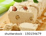Small photo of Pieces of halva with nuts on a cutting board