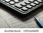 close up of  pen and calculator ... | Shutterstock . vector #150164600