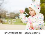 Cute Toddler Girl Blowing  ...