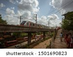Small photo of Mumbai,India,August-22-2019:Mumbai's Reliance metro rail line running through suburban slum area of Asalpha. It has reduced vehicular traffic easing load on roads and air pollution. It has also added