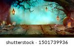 Stock photo halloween background with table and lanterns in dark forest in spooky night halloween design in 1501739936