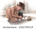 A Young Child Is Photographing...