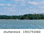 Small Sailboat In Full Sails A...