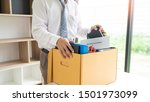 Small photo of businessman has a brown cardboard box and resignation letter write reason for resigning from work or unemployment and change job concept