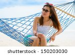 vacation woman relaxing on... | Shutterstock . vector #150203030