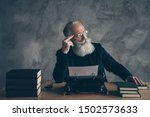 Small photo of Portrait of his he nice attractive bearded bewildered gray-haired professional expert creative publisher inspiration imagination genius idea solution deciding over concrete wall background