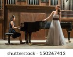 woman pianist plays the piano... | Shutterstock . vector #150267413