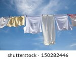 Stock photo laundry drying on the rope outside on a sunny day 150282446