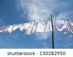 Stock photo laundry drying on the rope outside on a sunny day 150282950