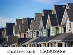 row of modern townhouses in... | Shutterstock . vector #150303686