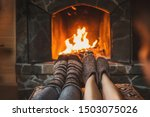Couple In Wool Socks Warming By ...