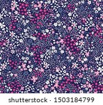Repeatable floral pattern consisting of colorful mini flowers on blue background.