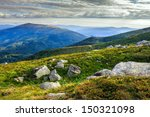 hilly slopes of high mountains strewn with large stones - stock photo
