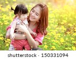 mother and daughter in the park | Shutterstock . vector #150331094
