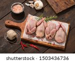 Raw quail preparation on wooden ...