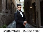 Businessman with classic suit with pavilion in Rome