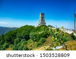 Shipka Monument (Monument of The Liberty) is a monumental construction, located at Shipka peak in Stara Planina mountain, near town of Shipka, Bulgaria at summer . artillery gun covere