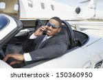 Young Businessman Using Cell...
