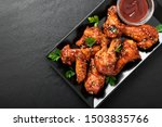 Small photo of Baked chicken wings with sesame and sauce. Traditional asian recipe.