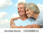 happy elderly couple on a sky... | Shutterstock . vector #150388814