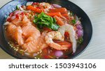 Spicy salmon salad with seafood ...