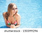sexy women in pool | Shutterstock . vector #150399296
