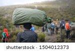 porter carrying heavy stuff on... | Shutterstock . vector #1504012373