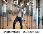 Small photo of Overjoyed funny male employee have fun perform winner dance in modern office hallway, excited happy millennial businessman celebrate business success or promotion, Friday evening, end of working week