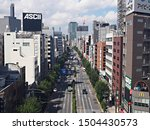 "Small photo of TOKYO/JAPAN - SEPTEMBER 7, 2019: Yasukuni Dori avenue and the buildings in Jimbocho district in Chiyoda ward. The billboard in the left ""ASCII"" is the business brand of KADOKAWA ASCII Research Lab."