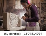 Female Sculptor Working On A...