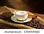 a cup of cappuccino and coffee... | Shutterstock . vector #150454460