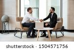 Small photo of Horizontal view european and arabian businessmen in formal wear accomplish meeting shaking hands feels satisfied after negotiations, HR manager greeting applicant before job interview process concept