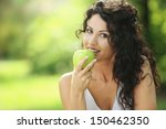 Beautiful Cheerful Woman Eatin...