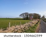 Small photo of Letham, Scotland - 12th April 2018: A beware of Horse Riders Sign on a Scottish Country Road one Spring Morning near Letham, in Angus Scotland.