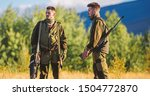 Small photo of Gamekeepers walk mountains background. Gamekeepers sunny fall day. Gamekeeper occupation concept. Hunting with partner provide greater safety fun and rewarding. Gamekeeper rifles nature environment.