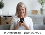 Smiling Mature Woman Holding...