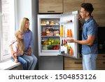 Happy Family Near Refrigerator...